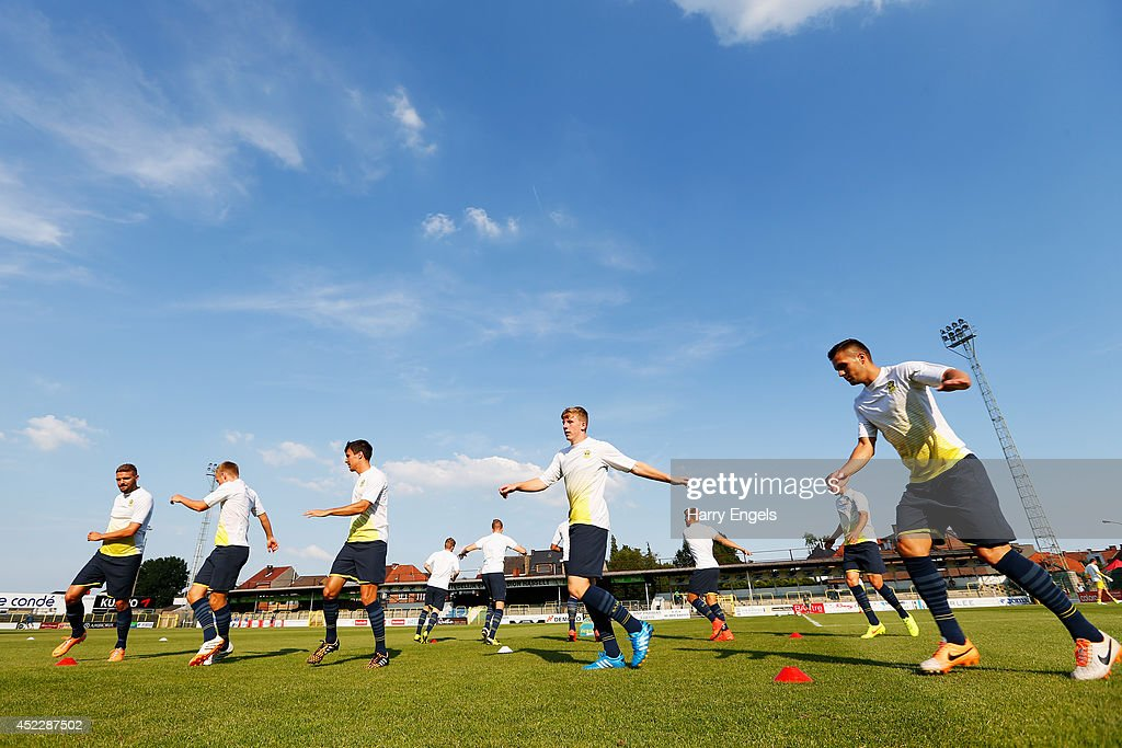 The Southampton team warms up ahead of the pre-season friendly match between KSK Hasselt and Southampton at the Stedelijk Sportstadion on July 17, 2014 in Hasselt, Belgium.