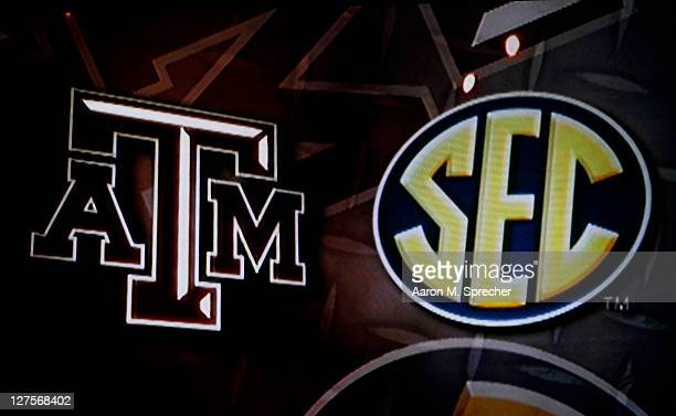 The Southeastern Conference logo and the Texas AM Aggies logo is seen on a screen during a press conference for Texas AM accepting an invitation to...