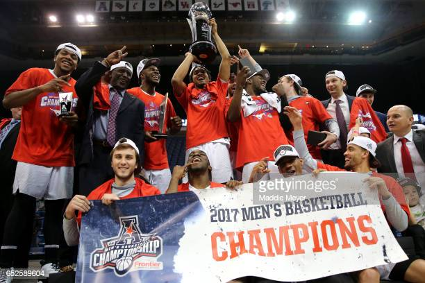 The Southern Methodist Mustangs celebrate after defeating the Cincinnati Bearcats 7156 during the championship game of the AAC Basketball Tournament...