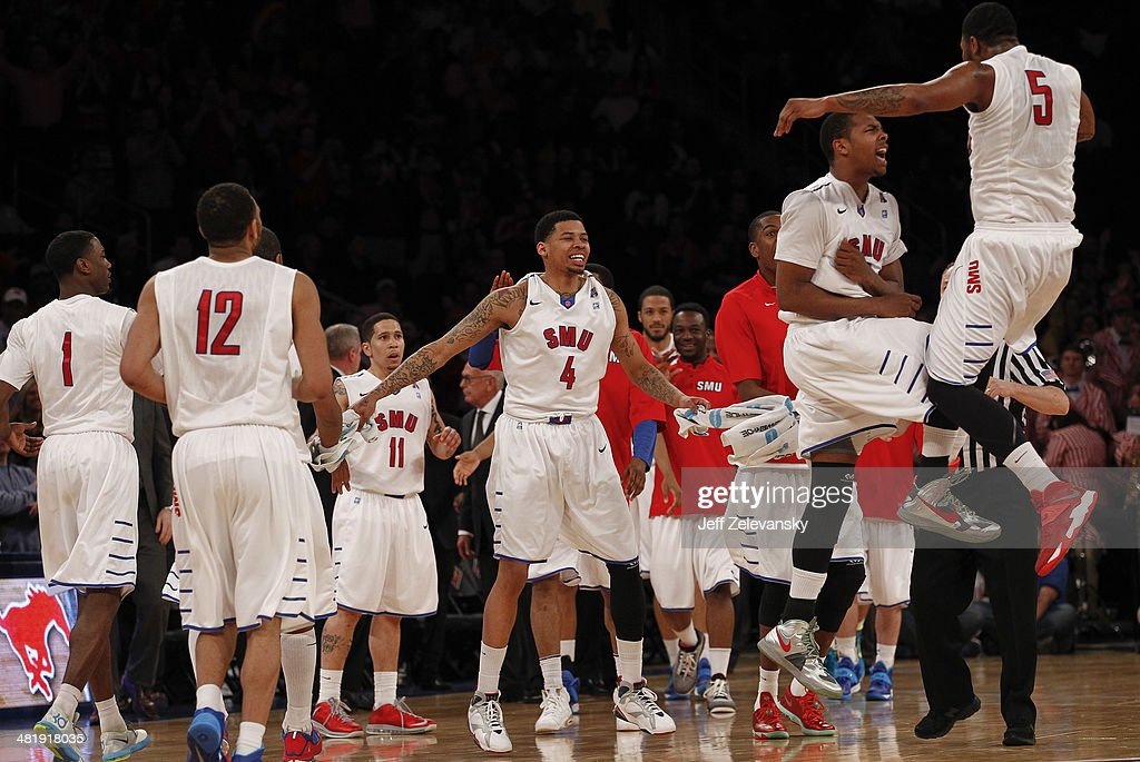 The Southern Methodist Mustangs celebrate during the NIT Championship semifinals against the Clemson Tigers at Madison Square Garden on April 1, 2014 in New York City.