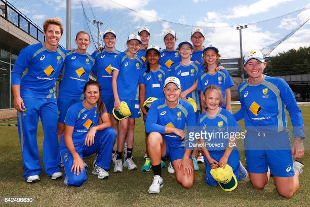 The Southern Stars pose for a photo with five young fans during a Southern Stars training session at Melbourne Cricket Ground on February 18 2017 in...