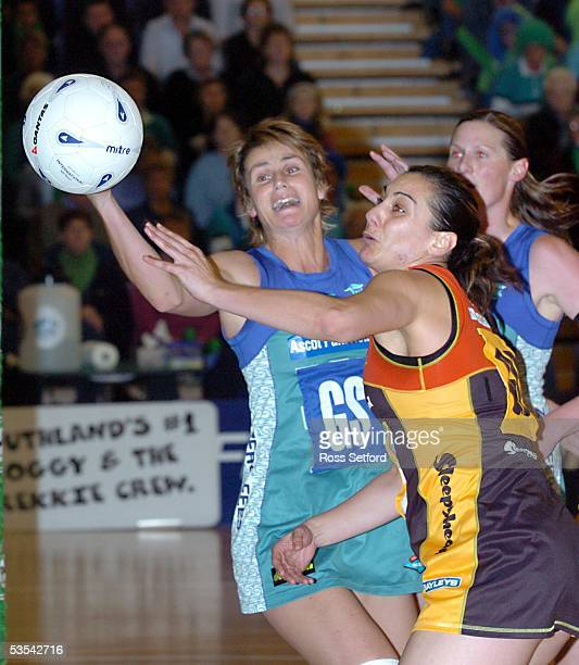The Southern Stings Tania Dalton left and Waikato Magic Joline Henry go for the ball in the final of the National Bank Netball Cup at Stadium...