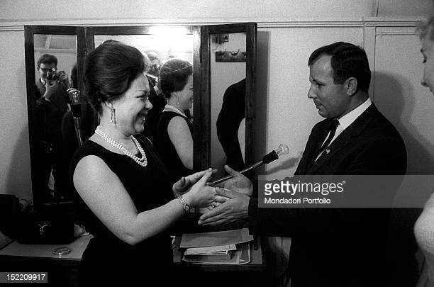 The Soviet astronaut Yuri Gagarin congratulates with the Italian soprano Renata Scotto who performed in the 'Turandot' Bolshoi Theatre Moscow...