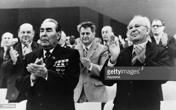 The Soviet leader Leonid I Brezhnev and Gustav Husak the Czech General Secretary applauding during the 16th Congress in Prague