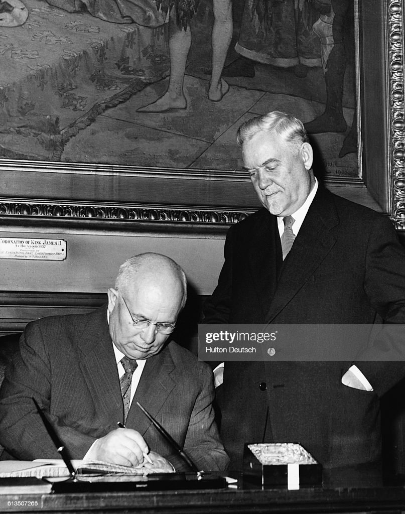 The Soviet leaders Nikolau Bulganin (r) and Niketa Khrushchev sign the visitors' book after a visit to Edinburgh's City Chambers.