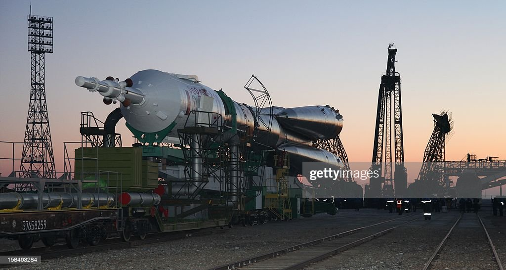 The Soyuz TMA-07M spaceship is transported to a launch pad at the Russian leased Kazakh Baikonur cosmodrome, on December 17, 2012. The launch of the of the next expedition to the International Space Station including Canadian astronaut Chris Hadfield, Russian cosmonaut Roman Romanenko and US astronaut Tom Marshburn, is scheduled on December 19. AFP PHOTO