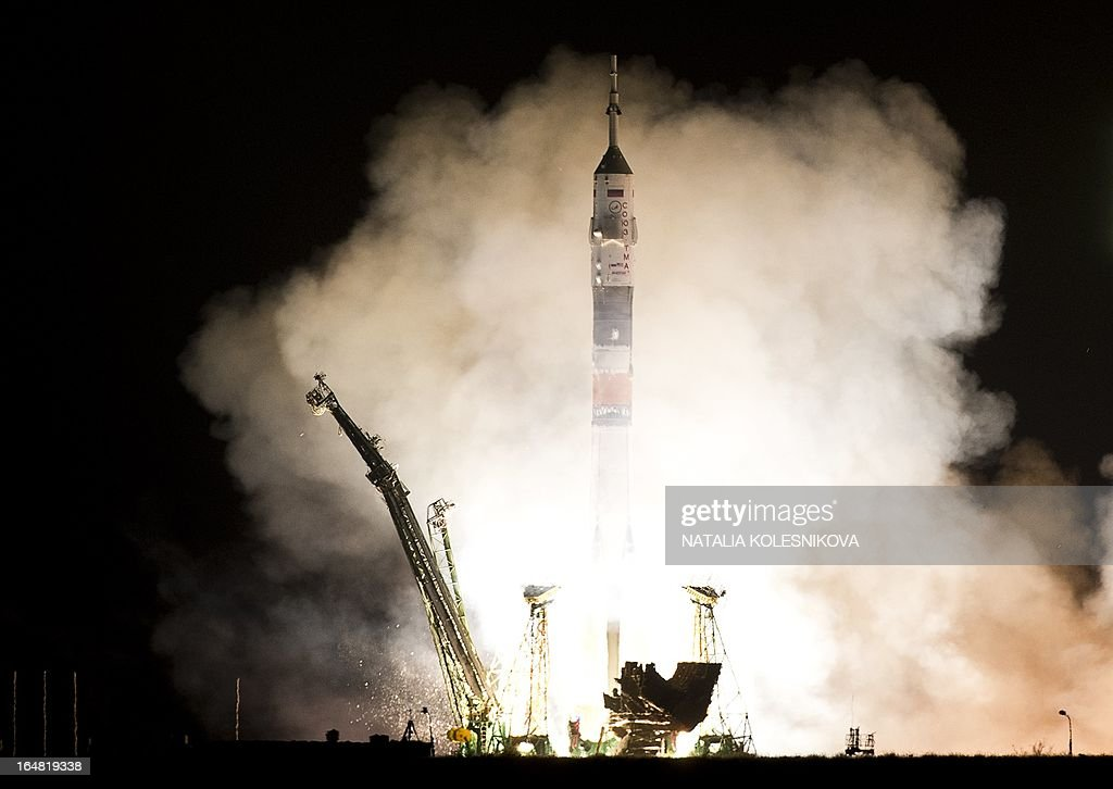 The Soyuz TMA-08M spacecraft blasts off from the Russian leased Kazakhstan's Baikonur cosmodrome early on March 29, 2013. A Russian rocket carrying an international crew of US astronaut Christopher Cassidy together with Russian cosmonauts Pavel Vinogradov and Alexander Misurkin blasted off today without a hitch to the International Space Station (ISS). AFP PHOTO/NATALIA KOLESNIKOVA