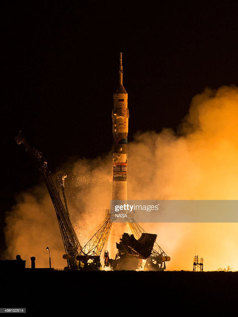 The Soyuz TMA14M rocket launches with Expedition 41 Soyuz Commander Alexander Samokutyaev of the Russian Federal Space Agency Flight Engineer Barry...