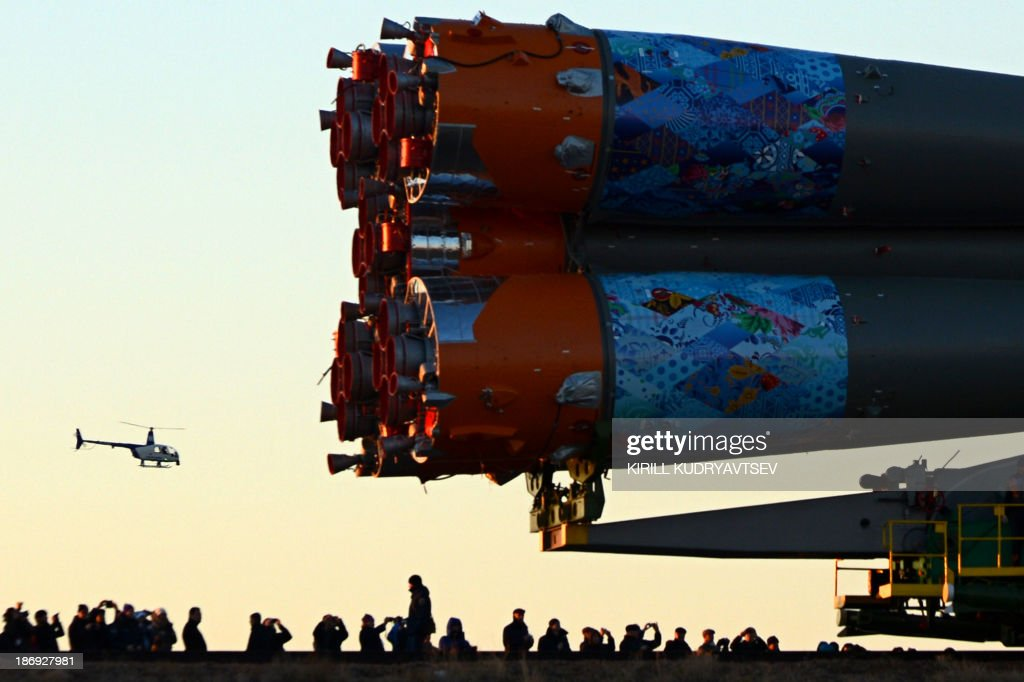 The Soyuz-FG launch vehicle with Soyuz TMA-11M spacecraft of the International Space Station (ISS) Expedition 39 aboard (partly seen R) is transported to a launch pad in the Russian-leased Baikonur cosmodrome in Kazakhstan, on November 5, 2013. The Soyuz TMA-11M with an international crew, including Japanese astronaut Koichi Wakata, Russian cosmonaut Mikhail Tyurin and US astronaut Rick Mastracchio, and with an unlit torch of Sochi 2014 Winter Olympic aboard is scheduled to blast off to the ISS from Baikonur on November 7. The torch is scheduled to return back to Earth on November 11. AFP PHOTO/KIRILL KUDRYAVTSEV