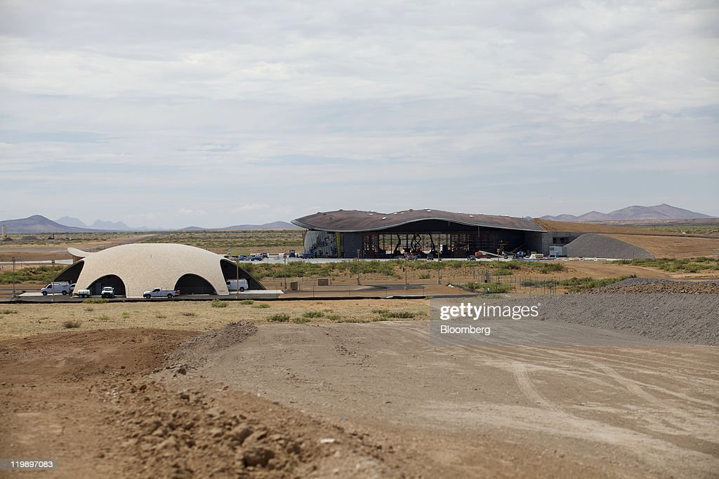 The Space Operations Center, left, and Terminal Hangar Facility stand at Spaceport America in Sierra County, New Mexico, U.S., on Thursday, July 14, 2011. The future home of Virgin Galactic is behind schedule and its director says it won't generate as many jobs as backers once claimed. Photographer: Christ Chavez/Bloomberg via Getty Images