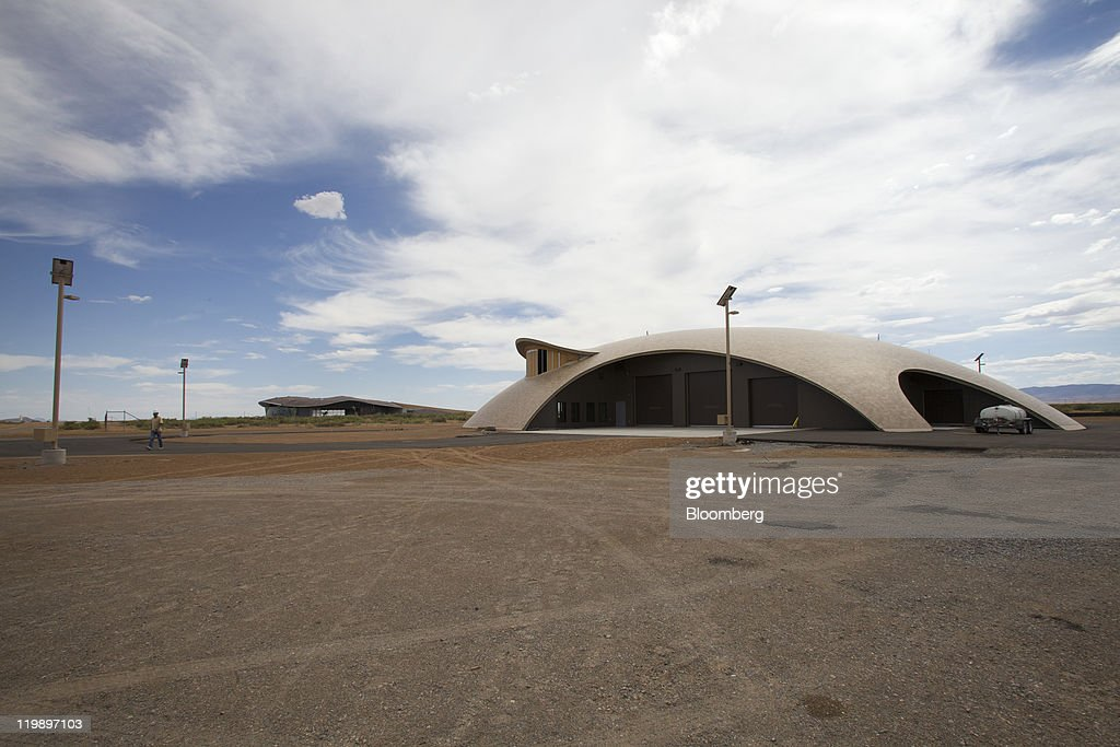 The Space Operations Center, right, and Terminal Hangar Facility, background, stand at Spaceport America in Sierra County, New Mexico, U.S., on Thursday, July 14, 2011. The future home of Virgin Galactic is behind schedule and its director says it won't generate as many jobs as backers once claimed. Photographer: Christ Chavez/Bloomberg via Getty Images