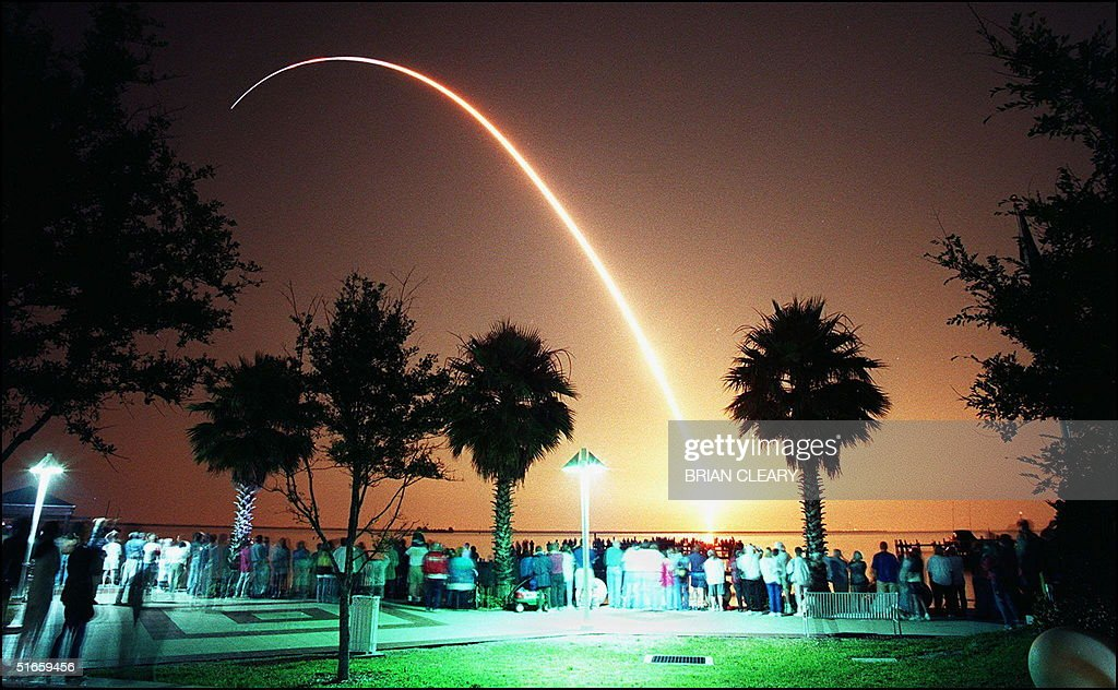 The Space Shuttle Atlantis streaks into the early morning sky 15 May from Kennedy Space Center's pad 39A in this time exposure photo take from...