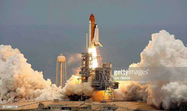 The Space Shuttle Atlantis STS125 blasts off from launch pad 39A at Kennedy Space Center on May 11 2009 in Cape Canaveral Florida Atlantis is...