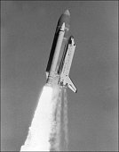 The Space shuttle Challenger lifts off on apparently flawless launch 28 January 1986 over Space Kennedy Center Challenger carrying seven crew members...