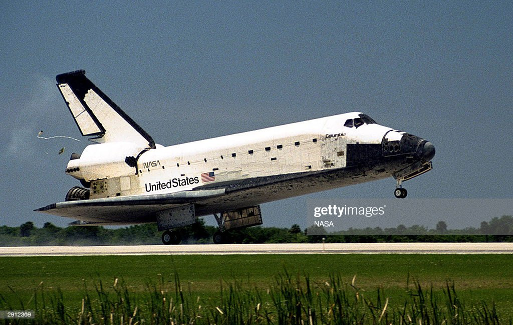 The Space Shuttle Columbia touches down on Runway 33 of Kennedy Space Center in Florida to complete the nearly 16-day STS-90 mission May 3, 1998. The one-year anniversary of the space shuttle Columbia disaster during reentry will be marked February 1, 2004.