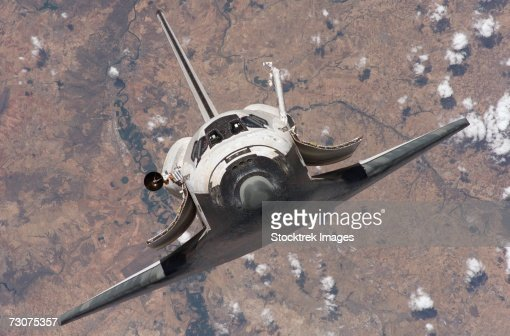 The Space Shuttle Discovery approaches the International Space Station for docking : Stock Photo