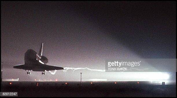 The Space Shuttle Discovery glides in for a landing 21 February on runway 15 at Kennedy Space Center FL The Discovery and its sevenman crew returned...
