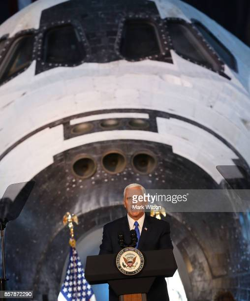The Space Shuttle Discovery is the back drop as Vice President Mike Pence speaks during the inaugural meeting of the National Space Council on...