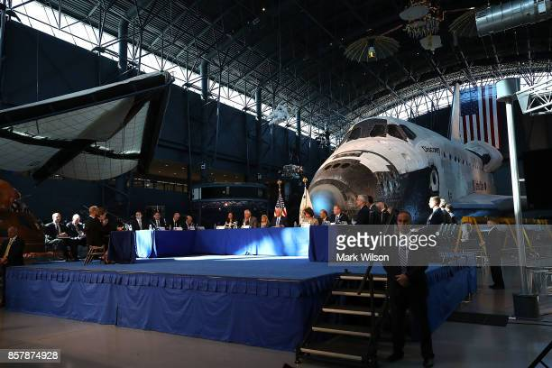 The Space Shuttle Discovery is the back drop as Vice President Mike Pence chairs the inaugural meeting of the National Space Council on 'Leading the...