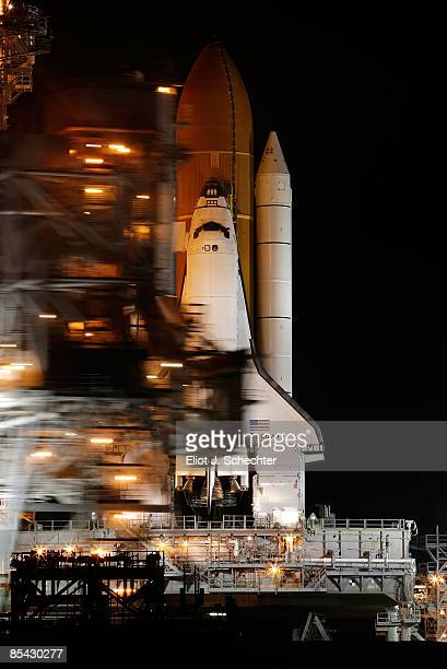 The Space Shuttle Discovery sits on launch pad 39A as the rotating service structure is rolled into launch position in preparation for a Sunday...
