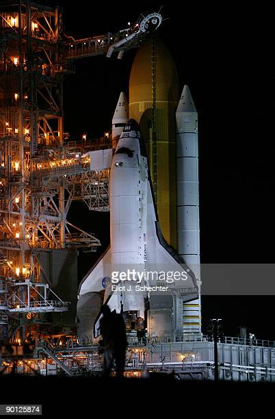 The Space Shuttle Discovery stands on launch pad 39A as it is prepared for launch after three earlier attempts were scrubbed at the at the Kennedy...