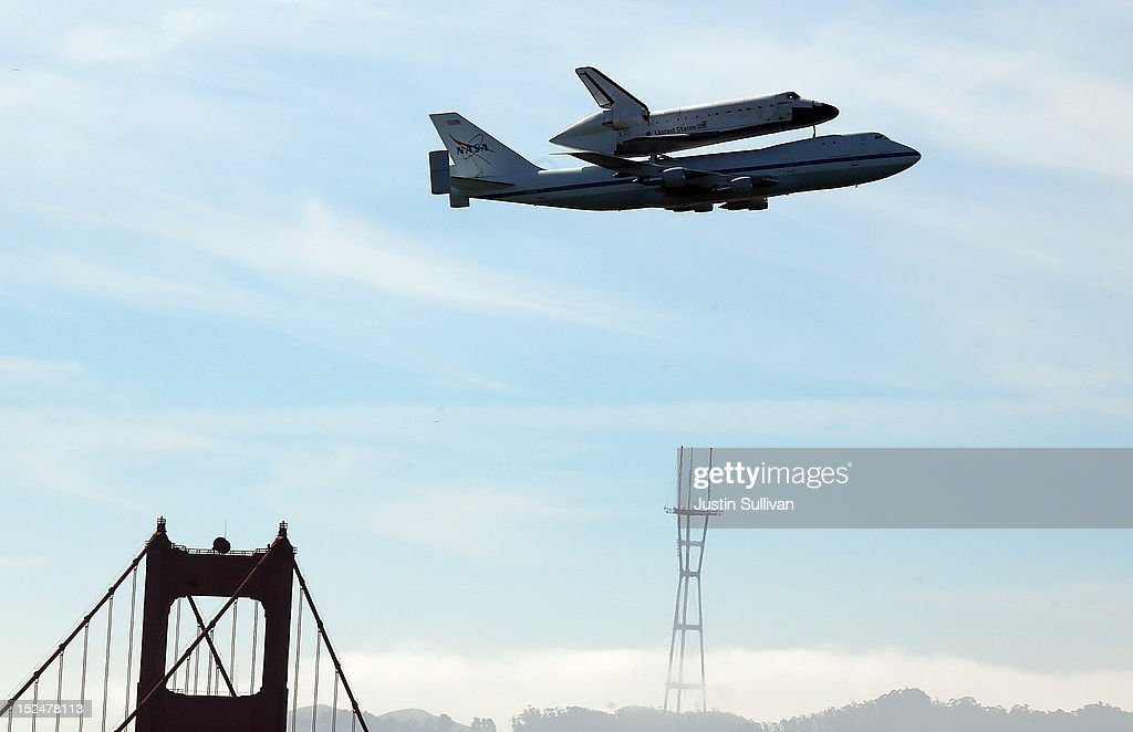 The Space Shuttle Endavour flies on top of a modified 747 jumbo jet over the Golden Gate Bridge and Sutro Tower as it travels to Los Angeles on September 21, 2012 in Sausalito, California. The Space Shuttle Endeavour did a 4-1/2 hour tour over California landmarks before heading to Los Angeles International Airport where it will be prepared to be moved to its new permanent home at the California Science Center in downtown Los Angeles. The shuttle will be on public display starting October 30.