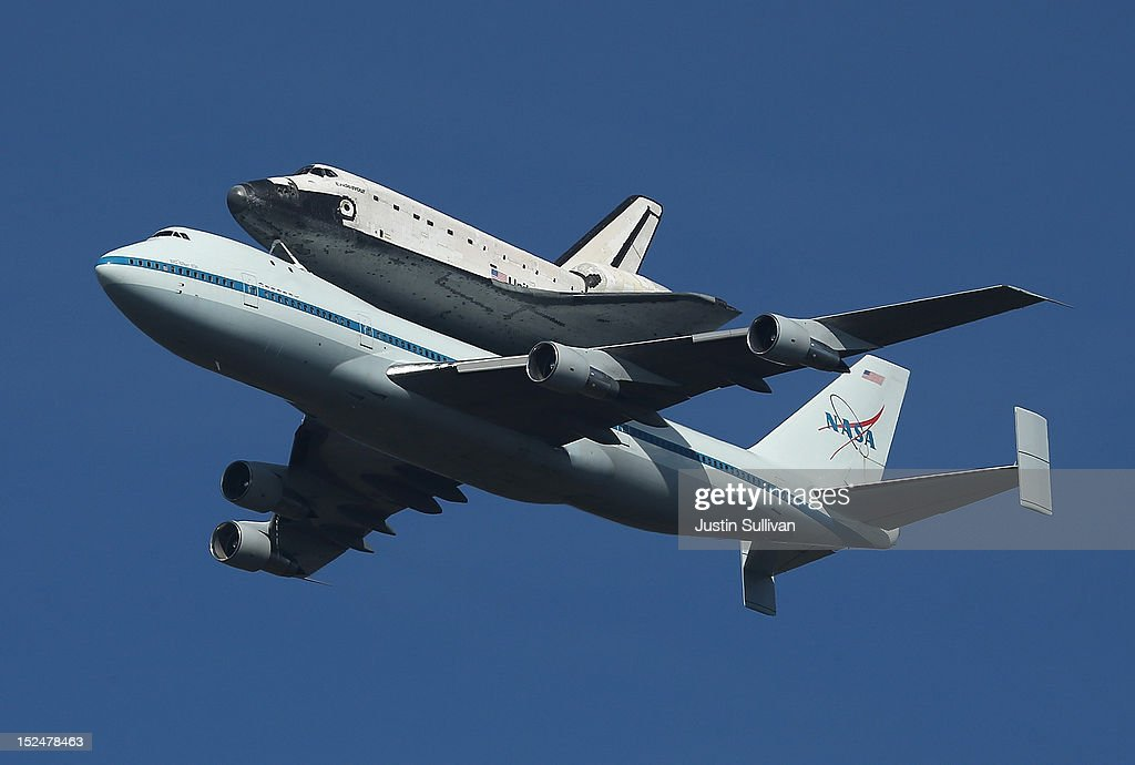 The Space Shuttle Endavour flies on top of a modified 747 jumbo jet en route to Los Angeles on September 21, 2012 in Sausalito, California. The Space Shuttle Endeavour did a 4-1/2 hour tour over California landmarks before heading to Los Angeles International Airport where it will be prepared to be moved to its new permanent home at the California Science Center in downtown Los Angeles. The shuttle will be on public display starting October 30.