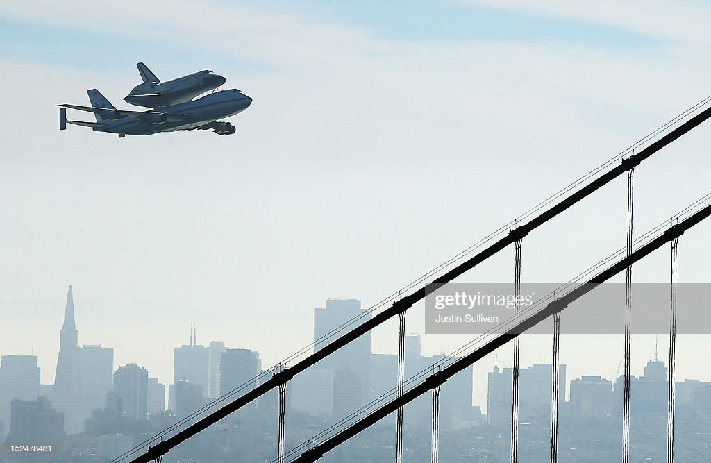 The Space Shuttle Endavour flies on top of a modified 747 jumbo jet over the Golden Gate Bridge as it travels to Los Angeles on September 21, 2012 in Sausalito, California. The Space Shuttle Endeavour did a 4-1/2 hour tour over California landmarks before heading to Los Angeles International Airport where it will be prepared to be moved to its new permanent home at the California Science Center in downtown Los Angeles. The shuttle will be on public display starting October 30.