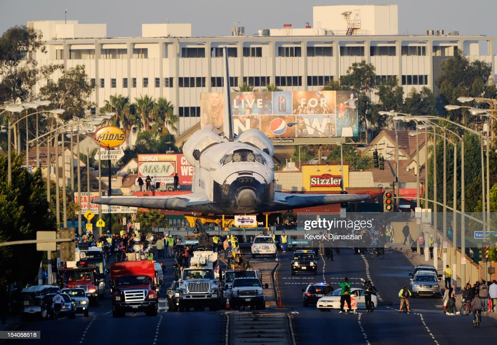 The space shuttle Endeavour arrives at The Forum arena for a stopover and celebration on its way to the California Science Center from Los Angeles International Airport (LAX) on day two on October 12, 2012 in Inglewood, California. The space shuttle Endeavour is on 12-mile journey from Los Angeles International Airport to the California Science Center to go on permanent public display.
