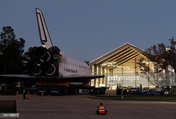 The Space Shuttle Endeavour is moved into the hangar in the California Science Center on October 14 2012 in Los Angeles California Endeavour is on...