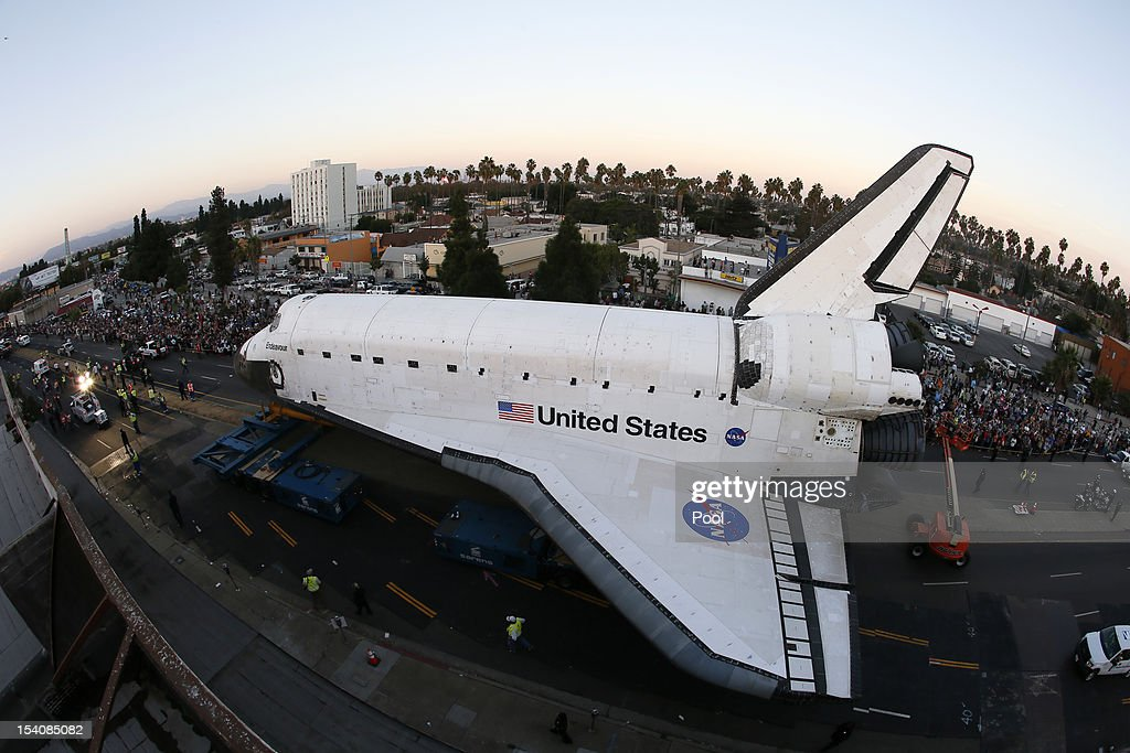 The Space Shuttle Endeavour is moved to the California Science Center on October 13, 2012 in Inglewood, California. The space shuttle Endeavour is on 12-mile journey from Los Angeles International Airport to the California Science Center to go on permanent public display.