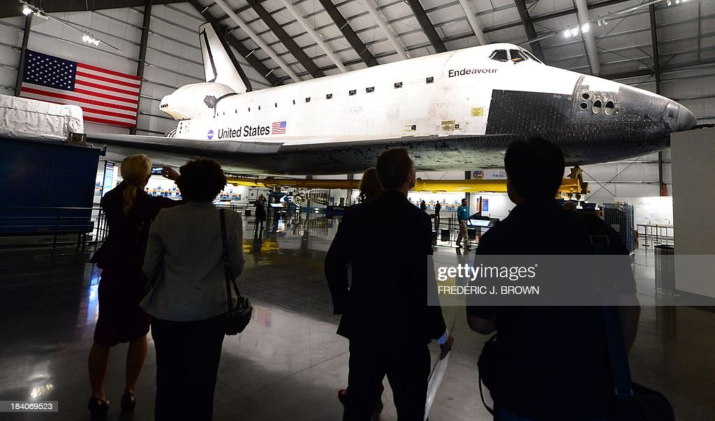 The Space Shuttle Endeavour is on display at the Samuel Oschin Pavilion at the California Science Center during a media preview ahead of the opening of Endeavour Fest, commemorating the one-year anniversary of the Endeavour's arrival in Los Angeles, on October 11, 2013 in California. While visitors to the three-day exhibition will also see a SpaceX Dragon spacecraft as well as the west coast launch of the Red Bull Stratos Exhibit, the lack of funding to NASA due to the government shutdown precludes their participation in Endeavour Fest, as NASA will not be able to provide exhibits or displays for the event and the NASA scientist presentations will be cancelled AFP PHOTO/Frederic J. BROWN