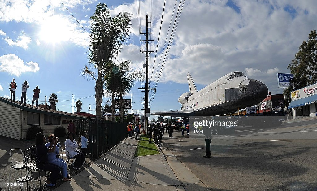 The Space Shuttle Endeavour is slowly moved along a city street on October 12, 2012 in Los Angeles, California. Endeavour is on its last mission - a 12-mile creep through city streets, past an eclectic mix of strip malls, mom-and-pop shops, tidy lawns and faded apartment buildings. Its final destination is the California Science Center in South Los Angeles where it will be put on display.