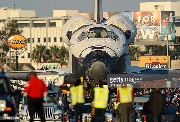 The Space Shuttle Endeavour is transported through the streets of Los Angeles and neighboring Inglewood on its final journey to its permanent museum...