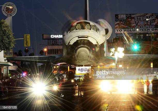 The Space Shuttle Endeavour is transported through the streets of Los Angeles on its final journey to its permanent museum home on October 13 2012 in...