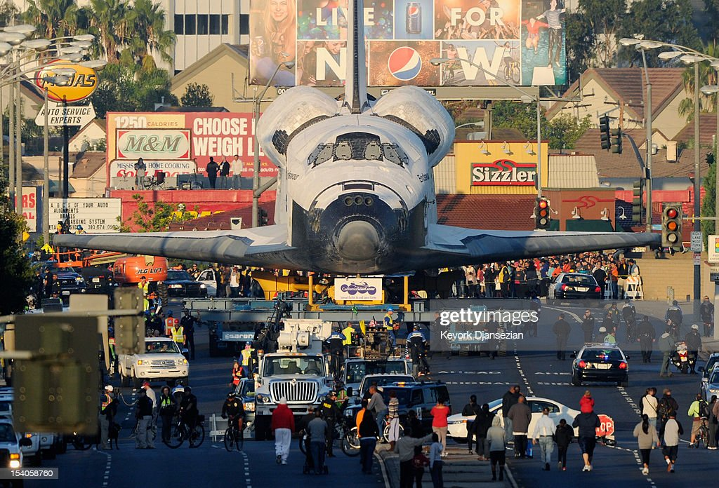 The space shuttle Endeavour is transported to The Forum arena for a stopover and celebration on its way to the California Science Center from Los Angeles International Airport (LAX) on day two on October 12, 2012 in Inglewood, California. The space shuttle Endeavour is on 12-mile journey from Los Angeles International Airport to the California Science Center to go on permanent public display.