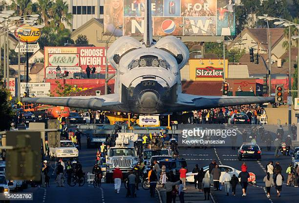 The space shuttle Endeavour is transported to The Forum arena for a stopover and celebration on its way to the California Science Center from Los...