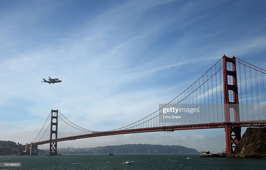 The space shuttle Endeavour, on top of NASA's Shuttle Carrier Aircraft or SCA, makes a pass over the Golden Gate Bridge before making its final landing in Los Angeles on September 21, 2012 in San Francisco, California.The Space Shuttle Endeavour will be placed on public display at the California Science Center. This is the final ferry flight scheduled in the Space Shuttle Program era.