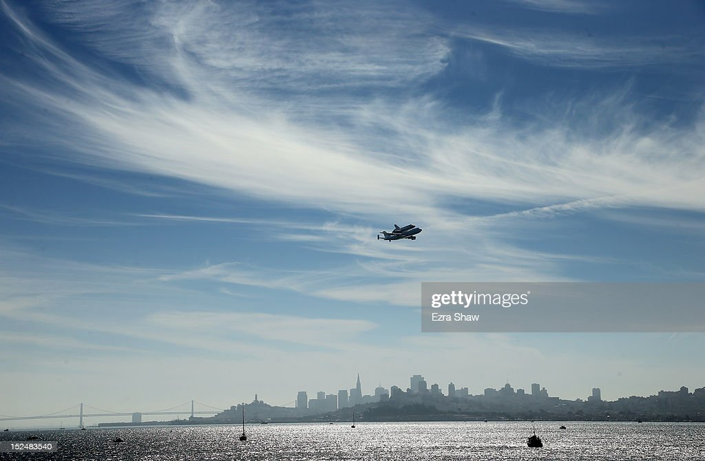 The space shuttle Endeavour, on top of NASA's Shuttle Carrier Aircraft or SCA, makes a pass over San Francisco before making its final landing in Los Angeles on September 21, 2012 in San Francisco, California. The Space Shuttle Endeavour will be placed on public display at the California Science Center. This is the final ferry flight scheduled in the Space Shuttle Program era.