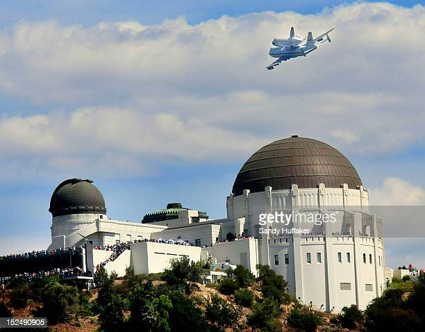 The space shuttle Endeavour on top of NASA's Shuttle Carrier Aircraft or SCA flies over the Griffith Park Obervatory on September 21 2012 in Los...