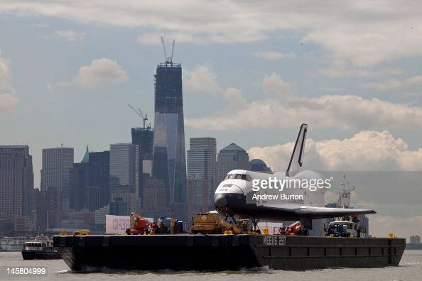 The space shuttle Enterprise is brought past the the Financial District on a barge on June 6 2012 in New York City The shuttle is on it's way to the...