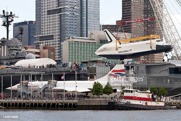 The space shuttle Enterprise is lifted by a crane on to the USS Intrepid on June 6 2012 in New York City NASA's space shuttle program came to an end...