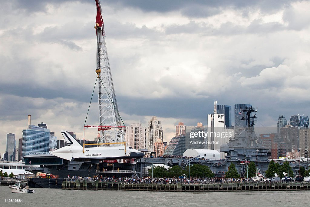 The space shuttle Enterprise is lifted by a crane on to the USS Intrepid on June 6, 2012 in New York City. NASA's space shuttle program came to an end in August, 2011, after 30 years of service. Upon the Intrepid, the space shuttle be on display for viewing by the general public.