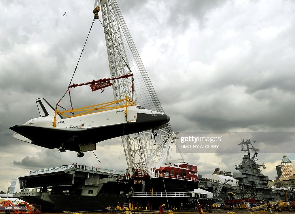 The space shuttle Enterprise is lifted from the barge to the flight deck New York June 6, 2012 as it arrives at the Intrepid Sea, Air and Space Museum where it will be permanently displayed. AFP PHOTO TIMOTHY A. CLARY