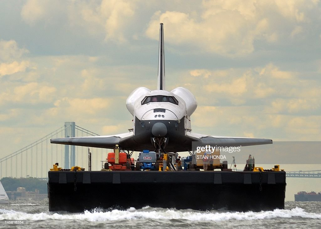 The space shuttle Enterprise is towed by barge through the harbor in New York June 6, 2012 to the Intrepid Sea, Air and Space Museum where it will be permanently displayed. AFP PHOTO/Stan HONDA