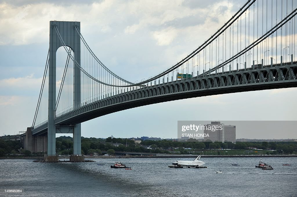 The space shuttle Enterprise is towed by barge under the Verrazano Bridge June 3, 2012 in New York on its way to dock in Port Elizabeth, New Jersey. Enterprise is scheduled to be moved by barge June 5 to the Intrepid Sea, Air and Space Museum in New York where it will be permanently displayed. AFP PHOTO / Stan HONDA