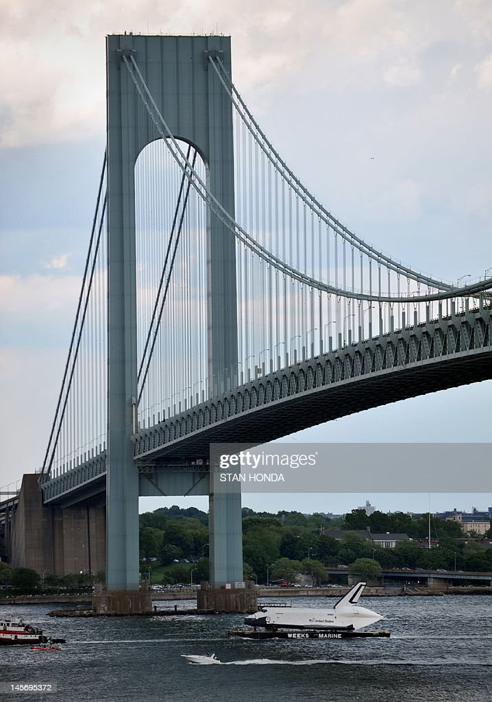 The space shuttle Enterprise is towed by barge under the Verrazano Bridge June 3, 2012 in New York on its way to dock in Port Elizabeth, New Jersey. Enterprise is scheduled to be moved by barge June 5 to the ntrepid Sea, Air and Space Museum in New York where it will be permanently displayed. AFP PHOTO / Stan HONDA