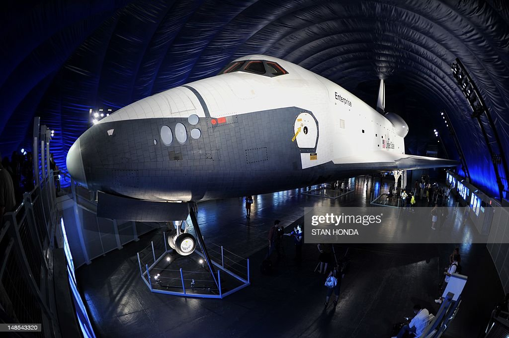 The Space Shuttle Enterprise seen on display at the Intrepid Sea, Air & Space Museum's Space Shuttle Pavilion during a press preview July 18, 2012 in New York. The exhibit will officially open to the public July 19. AFP PHOTO/Stan HONDA