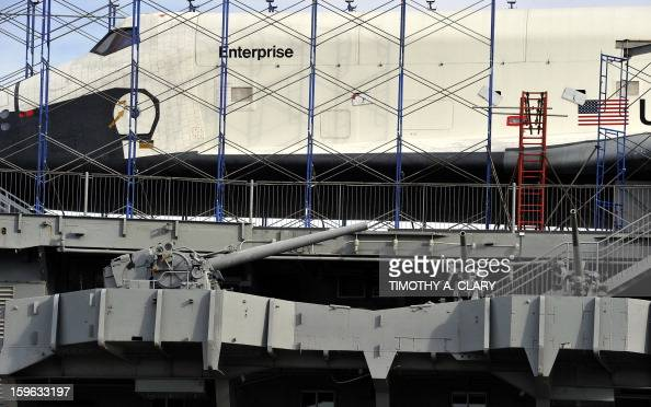 The Space Shuttle Enterprise sits on the flight deck of the Intrepid Sea Air Space Museum on January 17 2013 as it prepared for its opening in the...