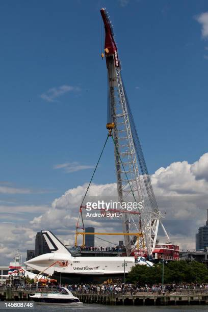 The space shuttle Enterprise waits to be lifted on to the USS Intrepid where it will be on display for viewing by the general public on June 6 2012...